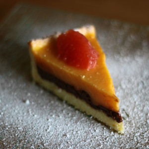 A slice of chocolate and grapefruit tart