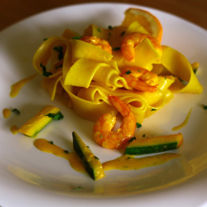 Creamy saffron pappardelle with courgette and king prawns