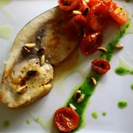 Grilled swordfish with confit tomatoes and pinenuts