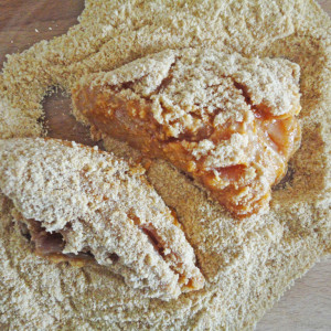 Coat the pieces of chicken in breadcrumbs on both sides