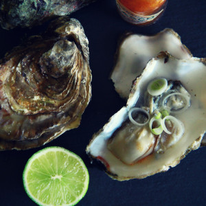 Oysters with tabasco, lime and spring onion