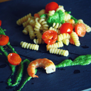 Fusilli bucati pasta with courgette, tomato and prawns