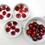 Arrange the cherries in the ramekins