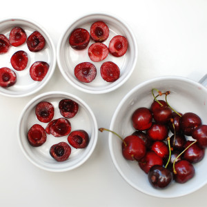Arrange the cherries in the ramekins