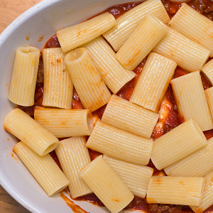 Arrange the Bolognese and pasta in an oven dish