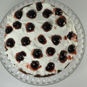 Liqueur, whipped cream and cherries