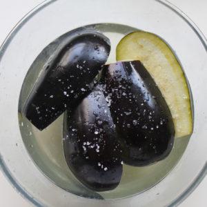 Slice the aubergines